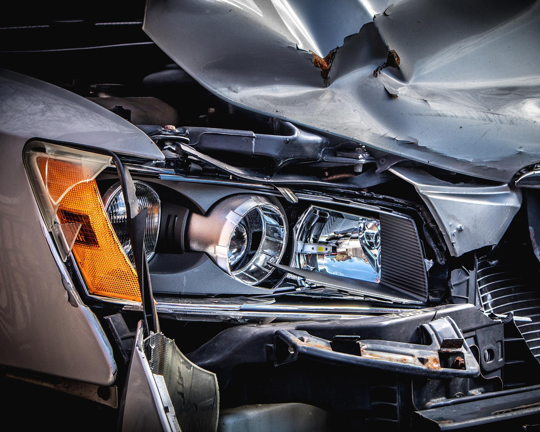 Headline area on a grey car after a car accident - Spitzer Legal Automotive Accident Practice Area