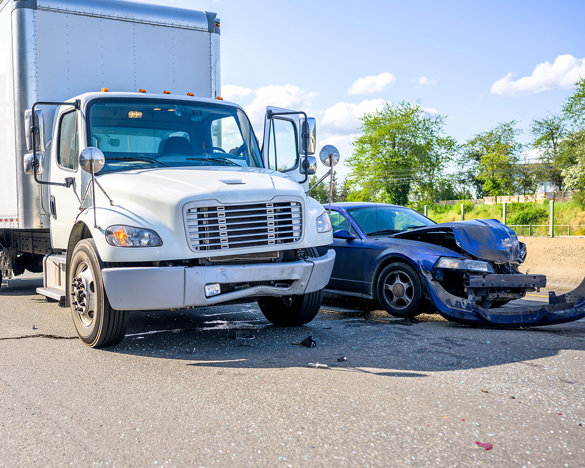 Commercial vehicle and passenger vehicle on the road after a crash - Spitzer Legal Commercial Vehicle Accident