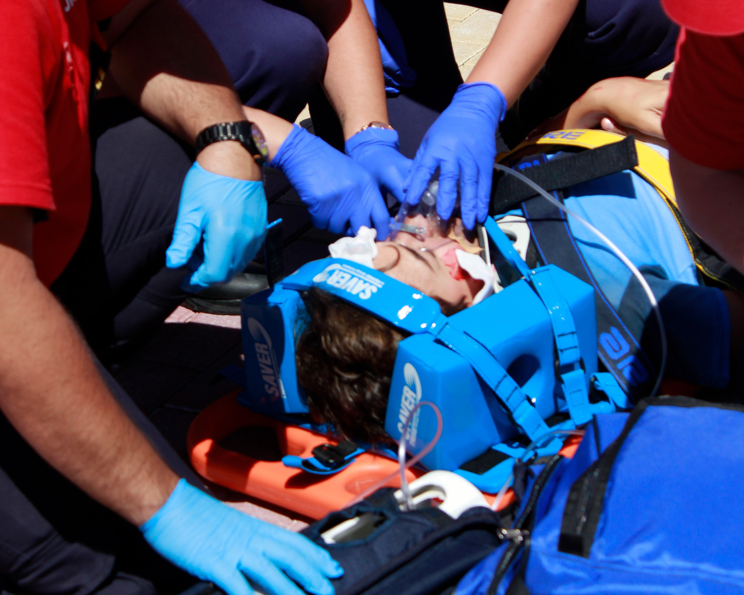 Person strapped to a board after an accident - Spinal Cord Injury